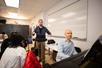 Contemporary-Music-Two-Men-Classroom-Conducting-Keyboard