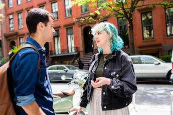 Admission Landing FAQ - Green Haired Woman Talking to Friend